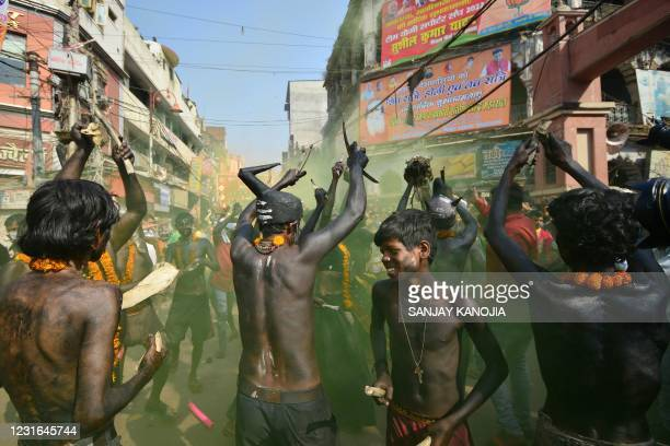 Devotees of Lord Shiva celebrate during a religious procession to mark the Hindu festival of Maha Shivratri in Allahabad on March 11, 2021.