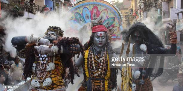 Devotees of lord Shiva decked up as Baraati during Shiv Barat on the occasion of Mahashivratri on March 4 2019 in Allahabad India Temples and shrines...