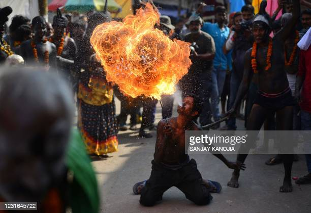 Devotees of Lord Shiva perform during a religious procession to mark the Hindu festival of Maha Shivratri in Allahabad on March 11, 2021.