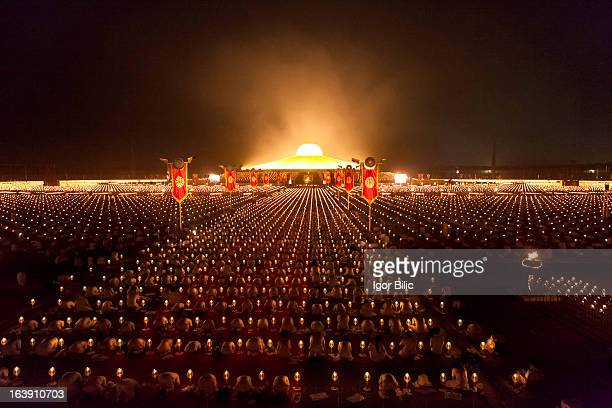 CONTENT] Devotees of the Dhammakaya Buddhist movement founded in Thailand pray during Makha Bucha day at Wat Phra Dhammakaya on the outskirts of...