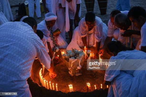 Devotees offer fruit and flowers during the day of Iemanja, goddess of the sea at Beach Camburi Cidade in Vitoria, Espirito Santo State, Brazil on 2...
