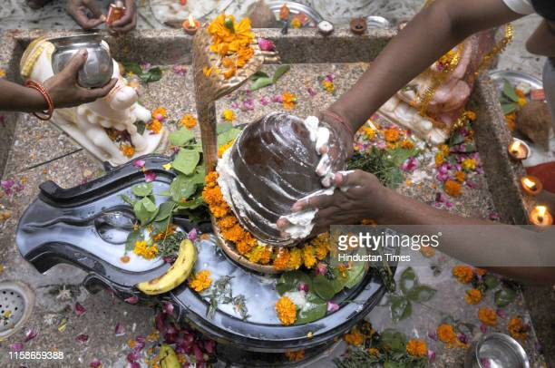 Devotees offer prayer to Lord Shiva on the day of Maha Shivratri at Lal mandir sector 2 on July 30 2019 in Noida India