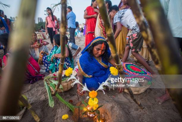 Devotees offer prayers at Girgaon Chowpatty during the sunset to mark Chhath Puja festival on October 26 2017 in Mumbai India Thousands of devotees...