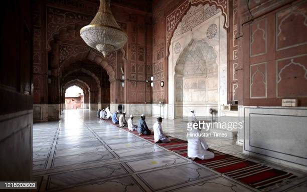 Devotees offer prayers at Jama Masjid while maintaining social distance, on June 7, 2020 in New Delhi, India. Places of worship are set to reopen...