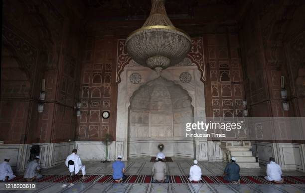 Devotees offer prayers at Jama Masjid while maintaining social distance on June 7 2020 in New Delhi India Places of worship are set to reopen from...