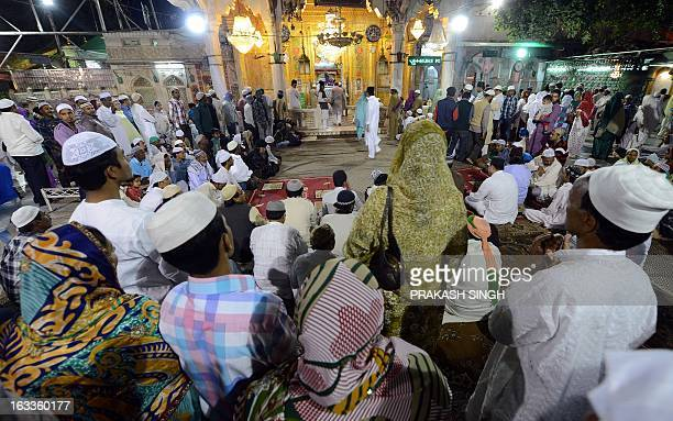 Devotees offer prayers in the Ajmer Sharif shrine in Ajmer on March 8 2013 The spiritual head of a revered Muslim shrine in India where Pakistan's...