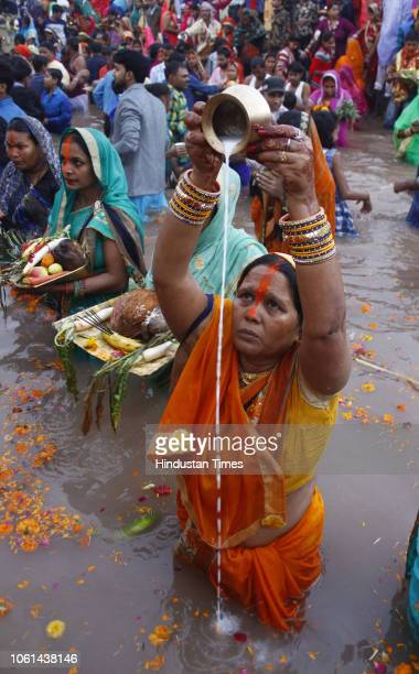 Devotees offer prayers to the Sun god after taking bath on occasion of Chhath puja on November 14 2018 in Gurugram India Thousands of devotees...
