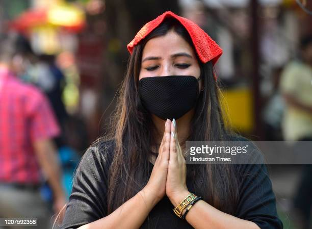Devotees offer their pray outside the Siddhivinayak Temple after State Govt issued notice to closed because of Corona pandemic on March 17 2020 in...