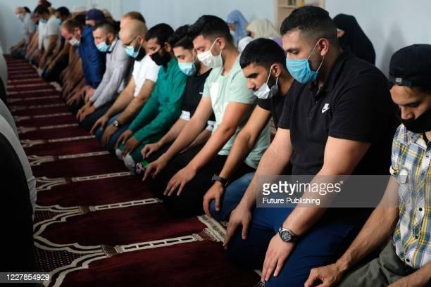 Devotees offer their prayers during the Eid al-Adha service at the Basmala Islamic Cultural Centre in Sievierodonetsk, Luhansk Region, eastern...