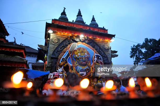 Devotees offered butter lamps infornt of Kaal Bhairab on the occasion of Navami ninth day of Dashain Festival at Basantapur Durbar Square Kathmandu...