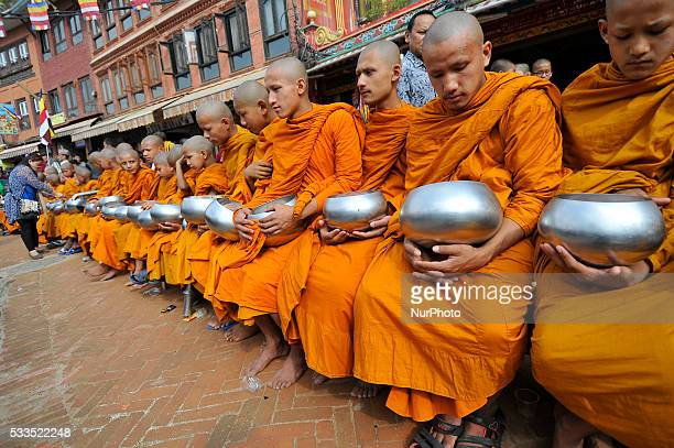 Devotees offering holy grains and money to Buddhist monks at the Boudhanath stupa one of the largest stupas in the world during celebration the...