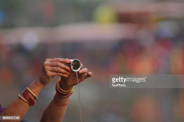 Devotees offering holy water towards sun god at Kamal Pokhari Kathmandu Nepal on Thursday October 26 2017 Chhath Puja Festival the worship of Sun God...