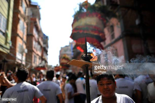 Devotees offering oil lamps during Lord Narayan jatra festival in Hadigaun Kathmandu Nepal on Friday October 06 2017 Once in a every year right after...