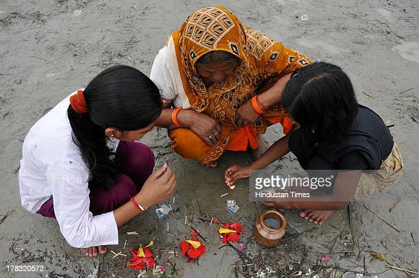 Devotees offering prayers on the beds of Saryu Ghat on August 28, 2013 in Ayodhya, India. Three days after Vishwa Hindu Parishad field Parikarma...