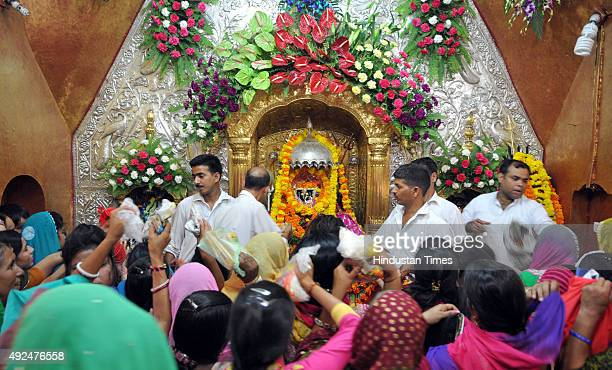 Devotees offering prayers on the first day of Navratras at Babe Wali Mata temple on October 13 2015 in Jammu India The ninedaylong Hindu Navratri...