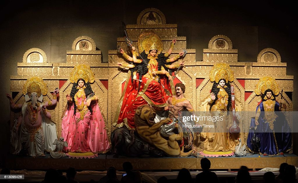Devotees offering prayers to lord Durga which is placed at Powai Bengali Welfare Association in Hiranandani Powai on the 5th day of Navratra Ustva on...