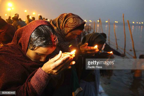 Devotees offers prayer after taking holy dip in river Ganges on the occasion of Makar Sankranti festival at Bank of river Ganges. Makar Sankranti is...