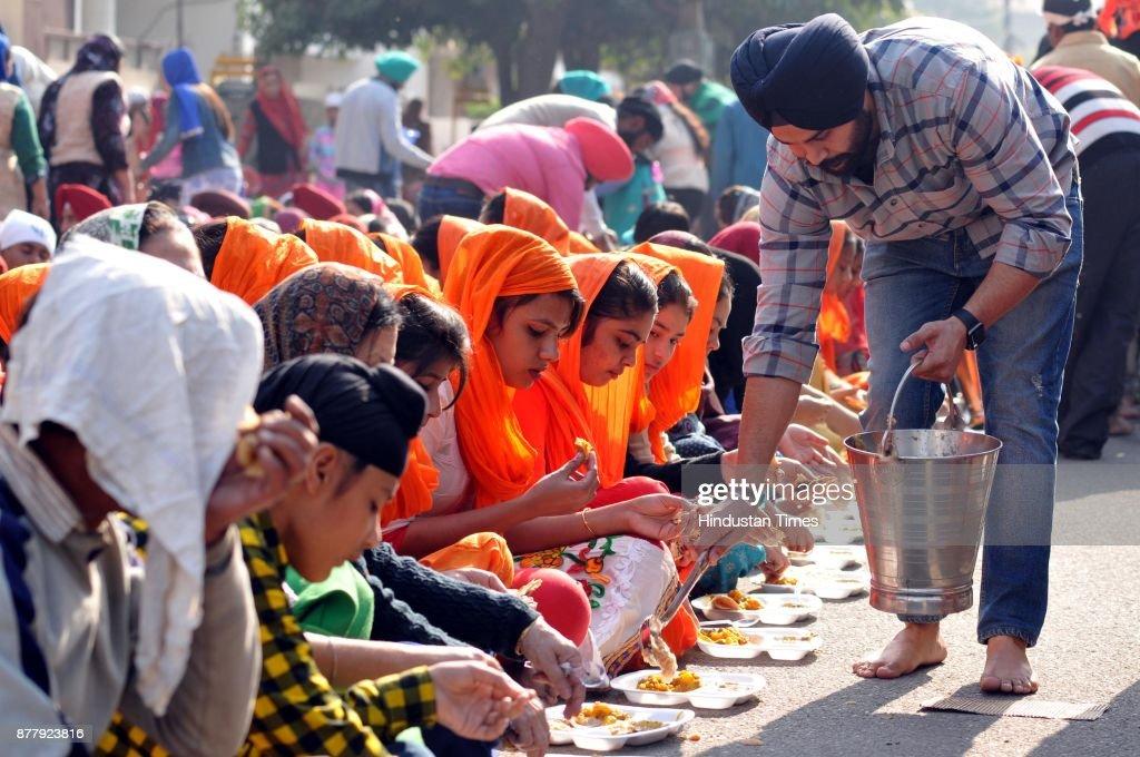 Devotees partaking in langar on the martyrdom day of Ninth Sikh Guru Tegh Bahadur at Gurdwara Nauvi Patshahi Guru Teg Bahadur Nagar on November 23...
