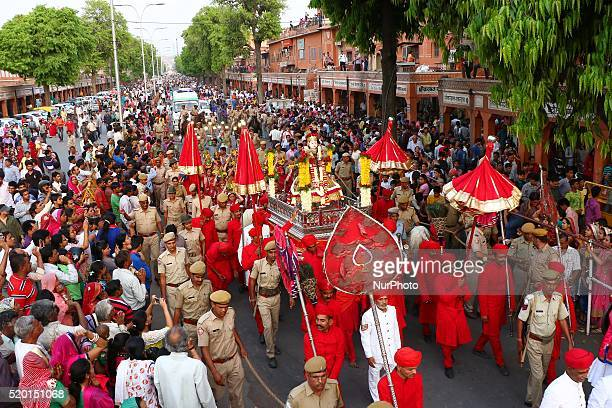 Devotees participate in a traditional 'Gangaur' procession on the occasion of Gangaur Festival in Jaipur Rajasthan India 9th April2016 Gangaur is one...