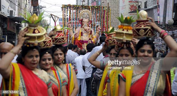 Devotees participate in Shobha Yatra and Mangal Murti Sthapna in Delhi Ka Maharaja, a Ganesh Mahotsav celebration by Ganesh Sewa Mandal in Laxmi...