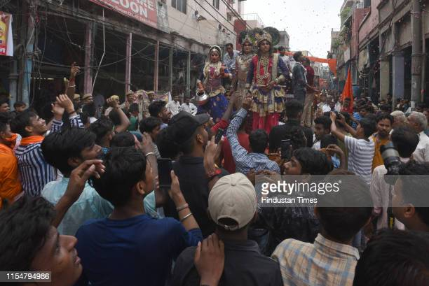 Devotees participate in the 'Shobha Yatra' procession at Hauz Qazi Lal Kuan Chandni Chowk area on July 9 2019 in New Delhi India The temple which was...