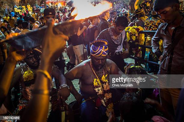 Devotees pass on blessing inside the Batu Caves during the Thaipusam procession on January 27, 2013 in Batu Caves, Malaysia. Thaipusam is a Hindu...
