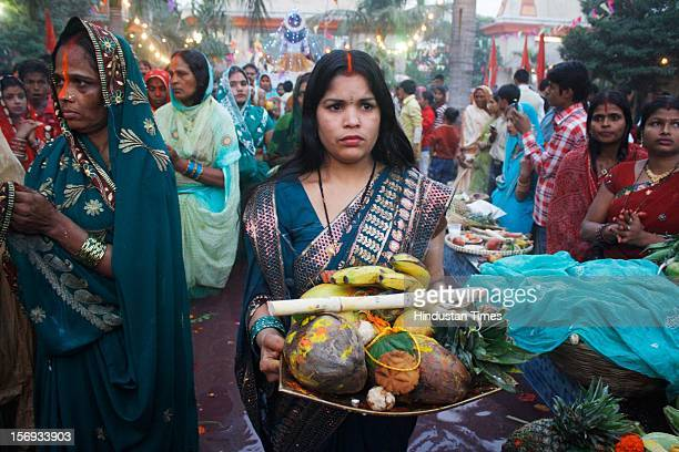 Devotees pay homage during the Chhath Puja, in Sanathan Temple at Sector 19, on November 19 in Noida, India. Chhath puja is a major festival of...