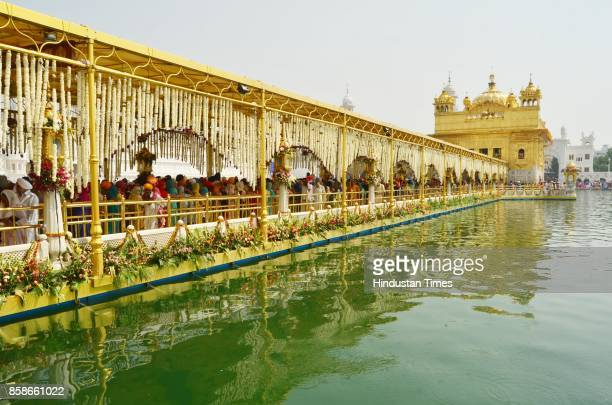 Devotees pay obeisance at Golden Temple on the occasion of birth anniversary of Guru Ram Das founder of the holy city Amritsar on October 7 2017 in...