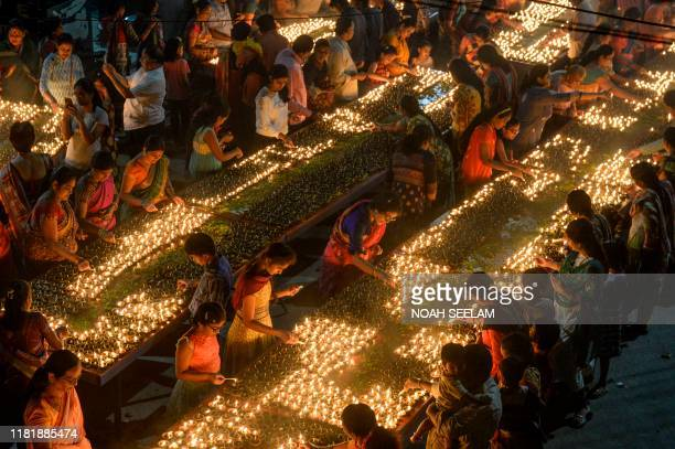TOPSHOT Devotees perform a ritual by lighting diyas on the occasion of Karthika or Kartik month in Hyderabad on November 12 2019 Karthika or Kartik...