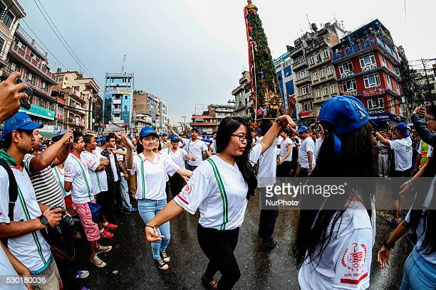 Devotees perform a tratition dance as they attend the chariot festival of Rato Machhindranath in Lalitpur near Kathmandu Nepal May 10 2016 The...