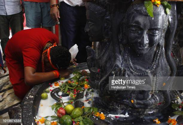Devotees perform 'abhishek' of Lord Shiva on the occasion of Shivratri festival at Gufa wala Shiv Mandir on August 9 2018 in Gurugram India