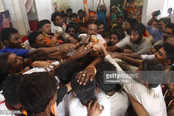 Devotees perform 'abhishek' of Lord Shiva on the occasion of Shivratri festival at Gufa wala Shiv Mandir on August 9 2018 in Gurugram India