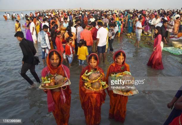 Devotees perform Chaiti Chhath rituals in the river Ganga at Danapur, on April 18, 2021 in Patna, India.