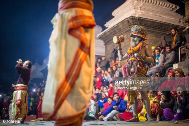 Devotees perform holy rituals at Pashupatinath temple in Kathmandu, Nepal.