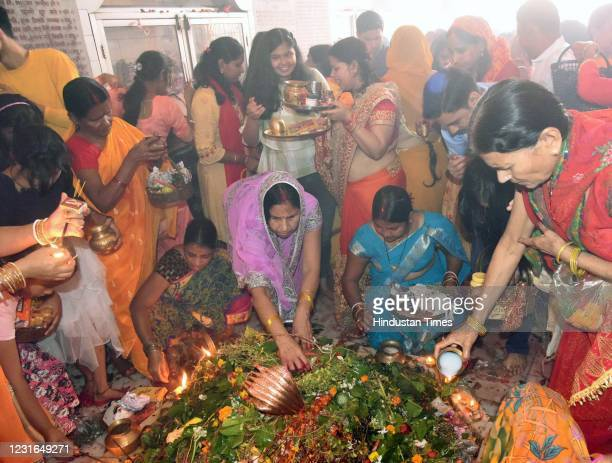 Devotees perform rituals at a temple on the occasion of Maha Shivratri festival, at Danapur, on March 11, 2021 in Patna, India. Maha Shivratri is...