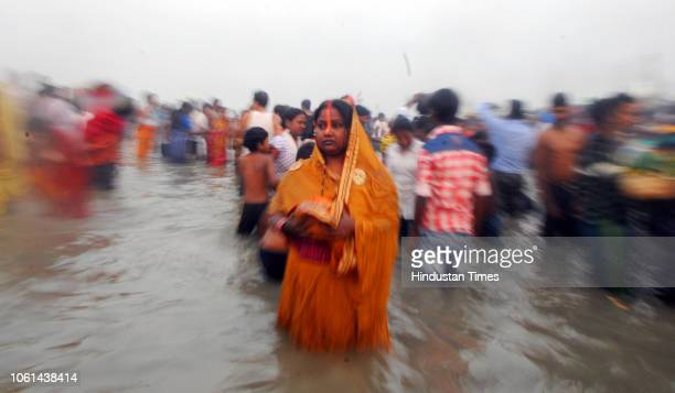 Devotees perform rituals of Chatth Mahaparva festival at river Ganga on November 14 2018 in Patna India Thousands of devotees celebrating Chhath Puja...