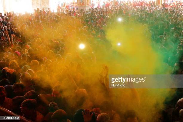 Devotees play with colors on the occasion of Holi festival celebration at historical Govind Dev Ji temple in Jaipur Rajasthan India on 01 March2018