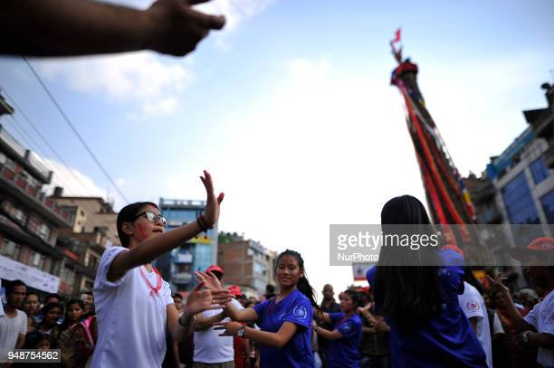 Devotees playing and dancing in a tunes of traditional instruments during Chariot pulling festival of Rato Machindranath 'God of Rain' on first day...