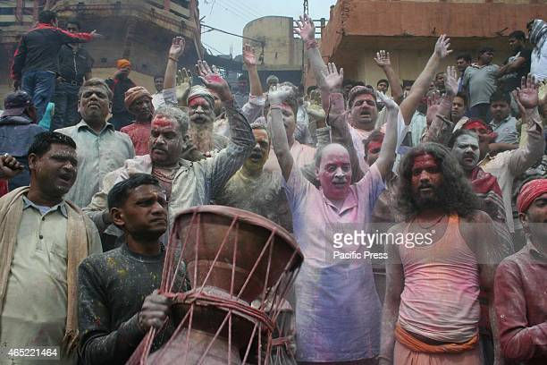 Devotees playing mythological and ancient holi manikarnika ghat in river bank of Ganga, Varanasi. Holi is an important festival to Hindus. It is...