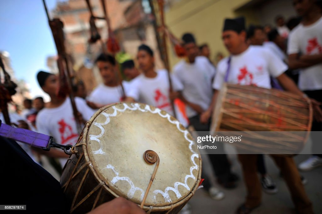 Devotees playing traditional drums as Locals carry and rotates top part of a chariot of Lord Narayan across the streets of Hadigaun during Lord Narayan jatra festival in Hadigaun, Kathmandu, Nepal on Friday, October 06, 2017. Once in a every year right after Dashain Festival this festival celebrates. The Narayan Jatra Festival of Hadigaun is a unique Festival in the capital involving three circular bamboo structures, above which an idol of the Lord Narayan in placed, and then rotated by two people standing below.