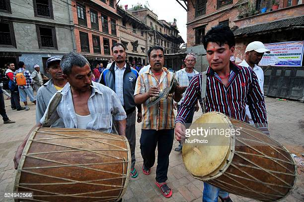 Devotees playing traditional instruments around Nava Durga Temple on the occasion of Biggest Dashain Festival at Bhaktapur Nepal on 21 October 2015...