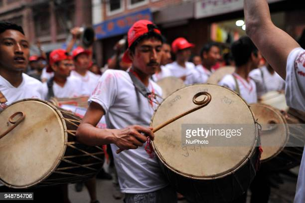 Devotees playing traditional instruments during Chariot pulling festival of Rato Machindranath 'God of Rain' on first day at Pulchowk Lalitpur Nepal...