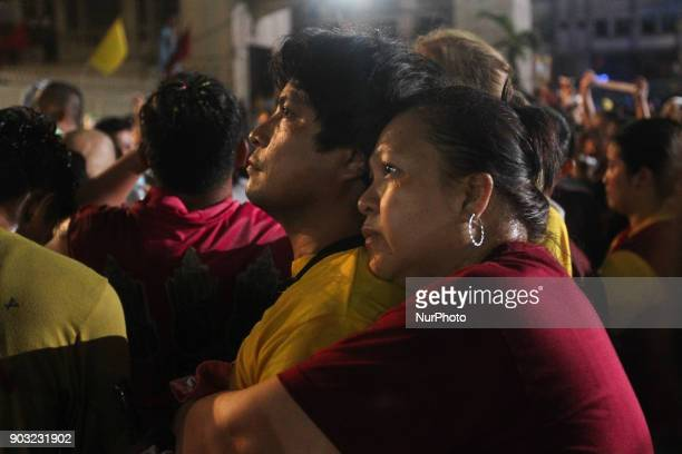 Devotees pray after the image of the Black Nazarene was successfully brought back inside the Quiapo Church in Manila early morning of 10 January 2017...