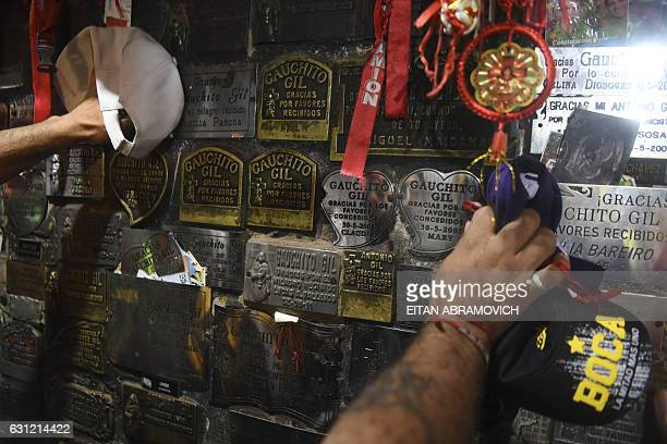 Devotees pray at the sanctuary of folk saint Gauchito Gil near Mercedes in the Argentine province of Corrientes on January 8 2017 The cult of...
