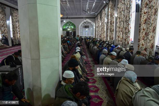 SRINAGAR JAMMU KASHMIR INDIA Devotees pray during the celebration at the Hazratbal Shrine in Srinagar Eid Milad Un Nabi is celebrated to pay tribute...