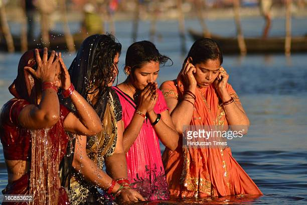 Devotees pray in Sangam waters , in Kumbh mela area, on February 7, 2013 in Allahabad, India.The mega religious fair is held once in 12 years in...