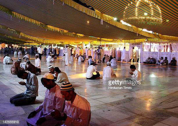 Devotees pray inside Hazart Khawaja Moinuddin Hasan Chisty Dargah on the eve of Pakistani President A A Zardari's visit on April 7 2012 in Ajmer...
