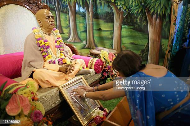 Devotees pray inside the temple at the Janmashtami Hindu Festival at Bhaktivedanta Manor on August 28 2013 in Watford England Up to 72000 were...
