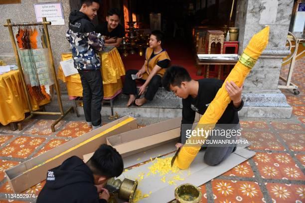 Devotees prepare large candles at Doi Suthep Buddhist temple in the northern Thai province of Chiang Mai on April 3 2019