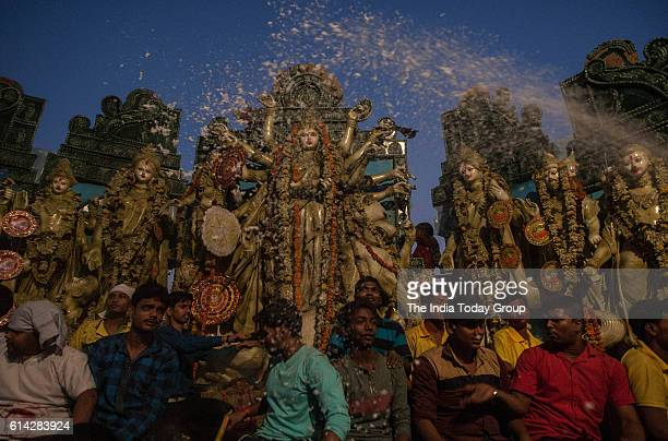 Devotees prepare to immerse an idol of the Hindu goddess Durga in the Yamuna River on the last day of the Durga Puja festival in New Delhi